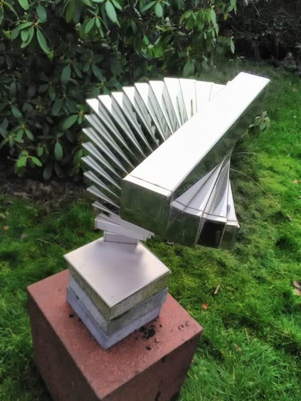 abstract geometric sculpture of stainless steel