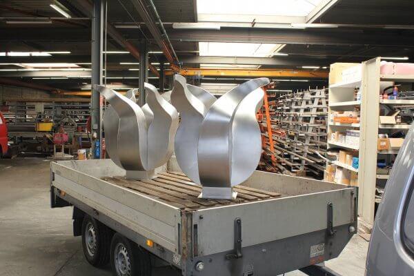 Stainless steel tulip artworks on trailer in workshop
