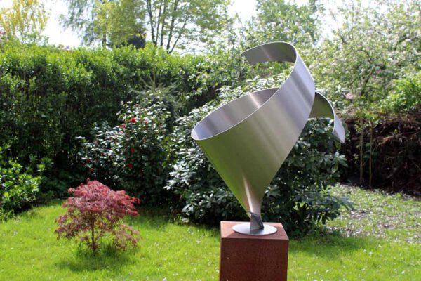 Modern stainless steel sculpture embrace