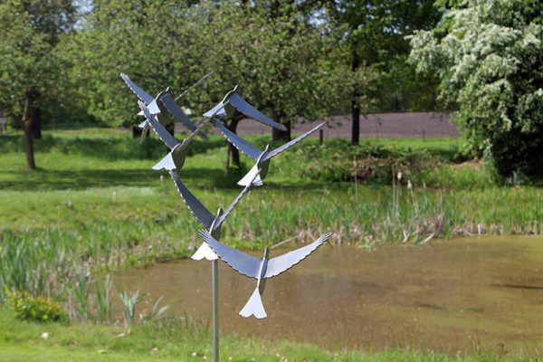 bird image of stainless steel on the water