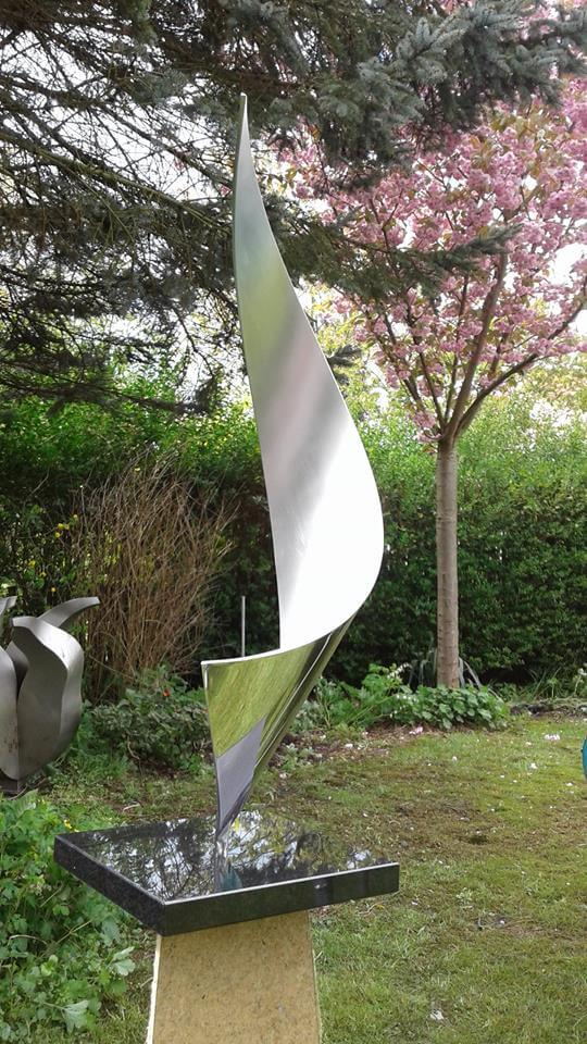modern abstract work of art made of stainless steel