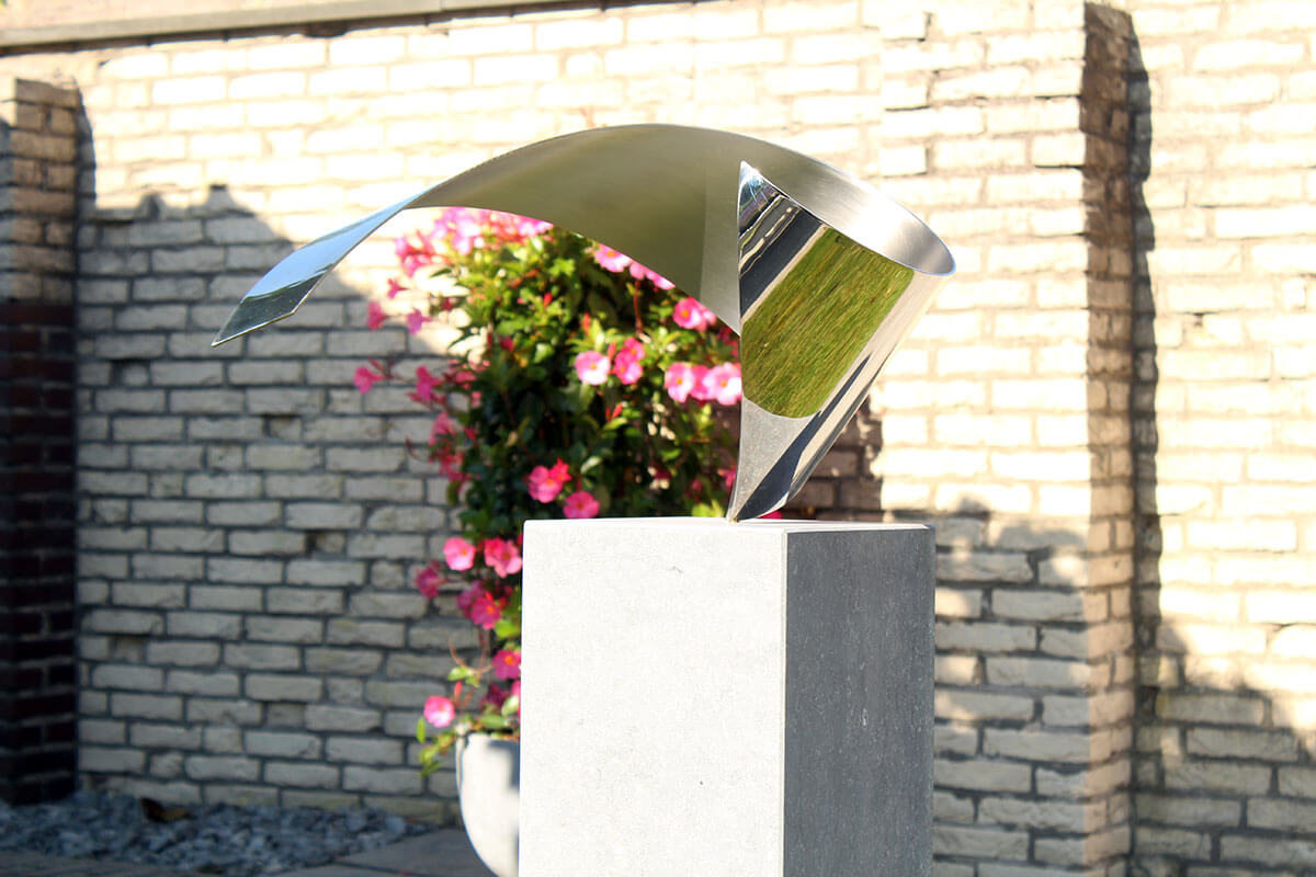 Wave art commissioned exclusive stainless steel sculpture for private garden