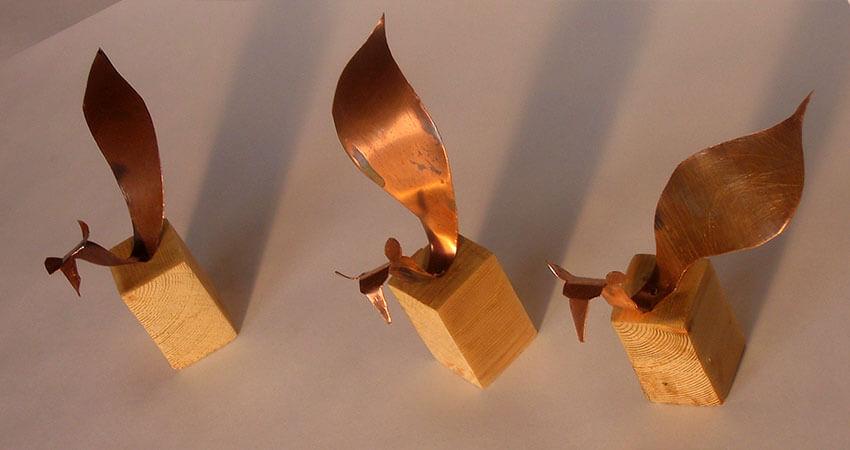 Small sketch designs in copper for figurative sculptures