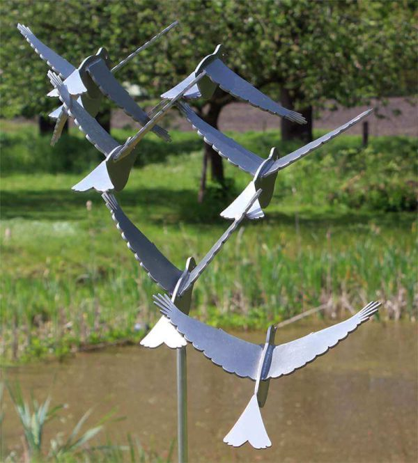 Stainless steel sculpture putter at pond