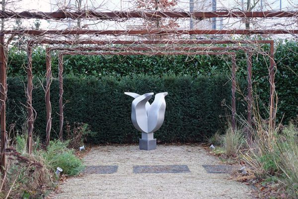 commissioned art - stainless steel tulip sculpture in the garden