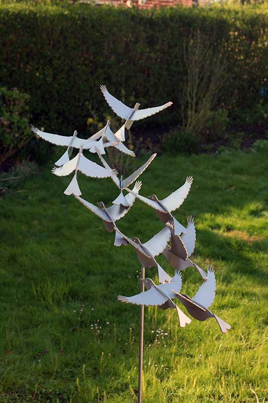 Stainless steel bird sculpture putter