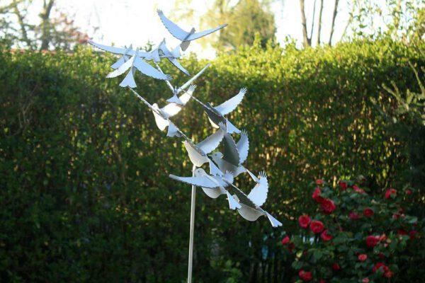 putter's stainless steel bird sculpture